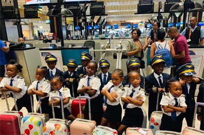 FEEL GOOD I Adorable Soweto Grade 1 kids show up at airport dressed in ultimate #AirSwag