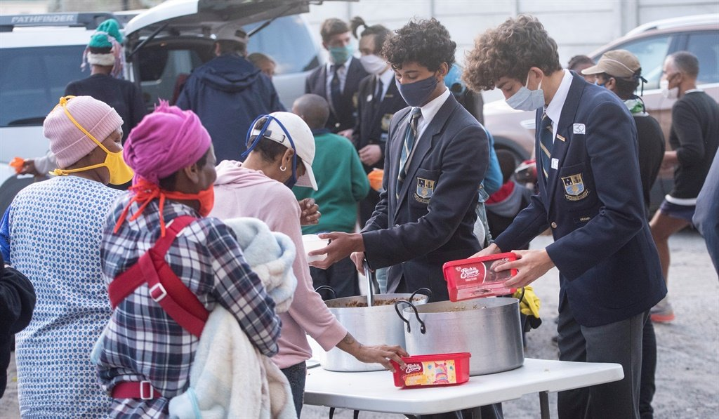 Rondebosch Boys High School Grade 11 learners donate 37 food parcels to the informal area 'Die Gatjie' in Diep River through the feeding scheme run by Howard and Odile Davids who have been helping the community in the surrounding areas for 18 years.