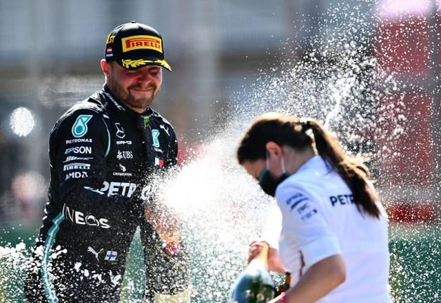 Austrian GP winner Valtteri Bottas celebrates on the podium during. (Photo by Clive Mason - Formula 1/Formula 1 via Getty Images)