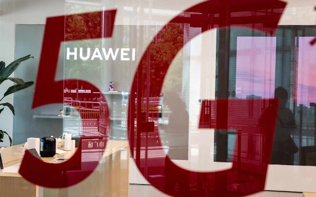"""Chinese telecom giant Huawei features a red sticker reading """"5G"""" in Beijing."""