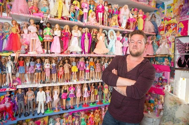Justuis Manefeldt and some of his Barbie dolls in a special room in his flat in Table View, Cape Town. (Photo: Misha Jordaan)