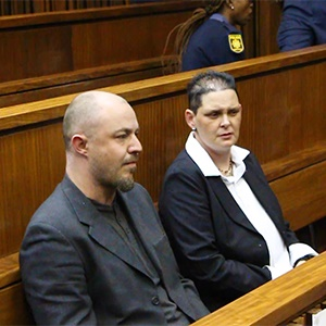Zak Valentine (left) and Cecilia Steyn (right) wait inside the South Gauteng High court in Johannesburg on Tuesday.