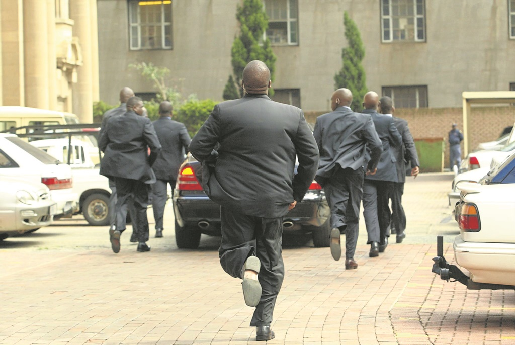 A file image of heavily protected Deputy President of the ANC Jacob Zuma arrives at the Johannesburg Supreme Court for his rape trial.