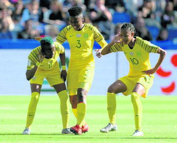 FLEET FEET SA's Thembi Kgatlana (left) celebrates scoring the first goal of the game against Spain in the Fifa Women's World Cup yesterday. Picture: Richard Sellers