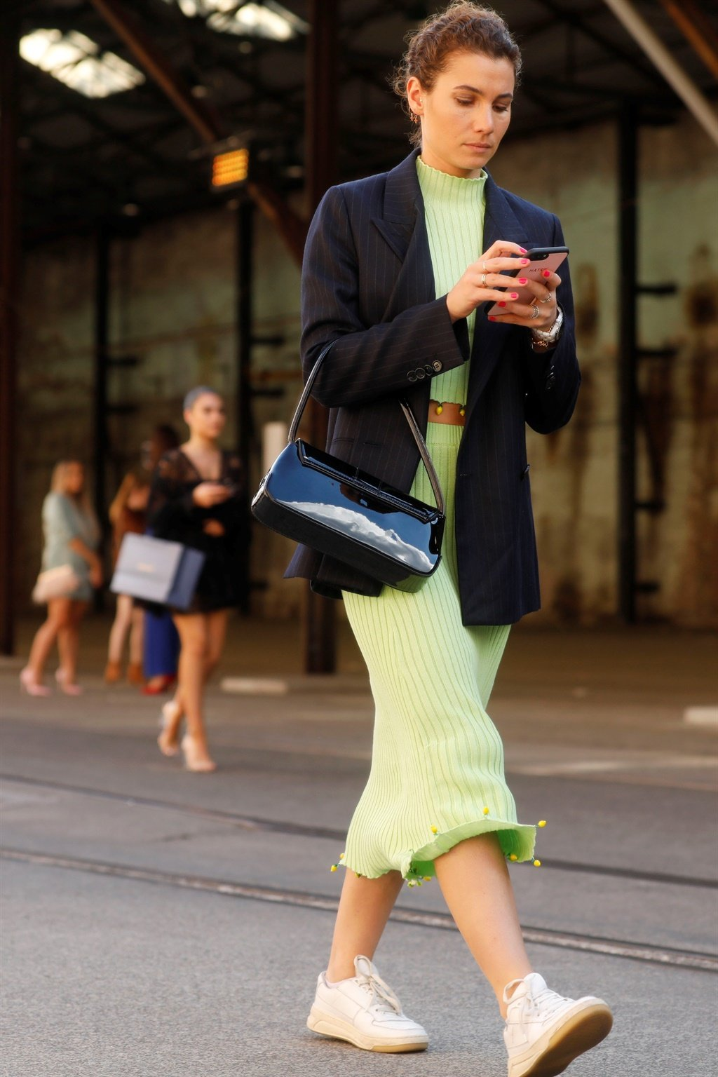 SYDNEY, AUSTRALIA - MAY 15: A guest wearing neon g
