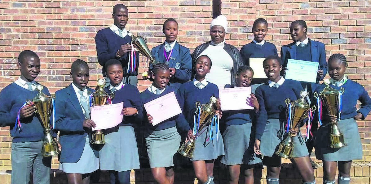Miss Mkhize (back middle) with the pupils who won at the Readers' Cup competition. photo: supplied