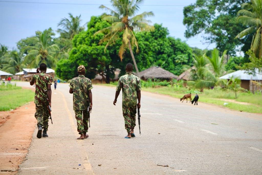 Soldiers from the Mozambican army patrol the streets on 7 March 2018 in Mocimboa da Praia, Mozambique, after security in the area was increased, following a two-day attack from suspected islamists.