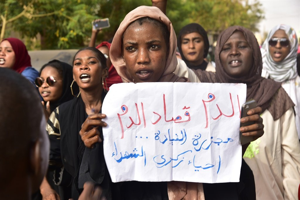 Sudanese protesters take part in a demonstration the Sudanese capital's twin city of Omdurman, to mourn dozens of demonstrators killed last month in a brutal raid on a Khartoum sit-in, on July 13, 2019. Crowds of protesters were violently dispersed by men in military fatigues in a pre-dawn raid on a protest site outside army headquarters on June 3. (Ahmed Mustafa, AFP)