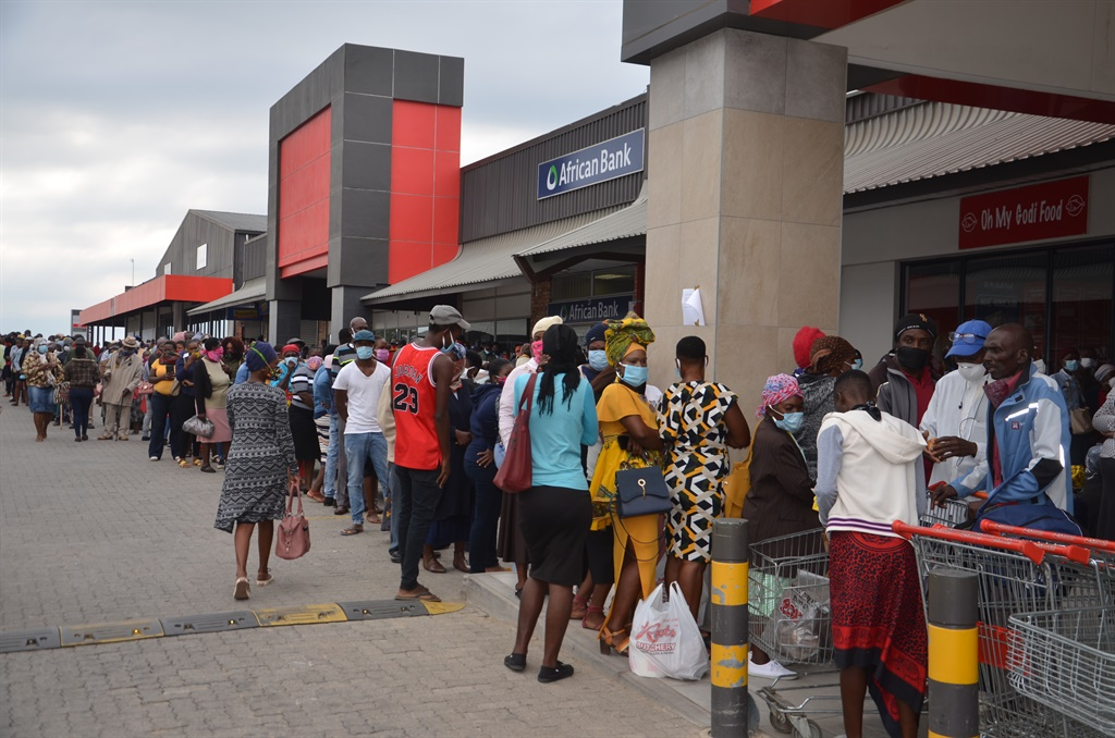 Unemployed beneficiaries on lines to get their Sassa special Covid-19 social relief grants at Thulamahashe mall.