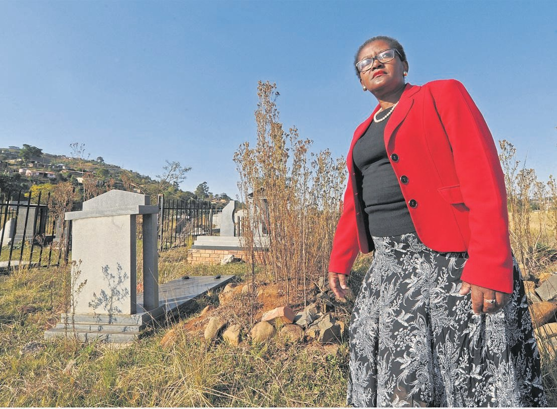 Khanyisile Nyembezi at the Edendale Cemetery, which has fallen into a state of disrepair.
