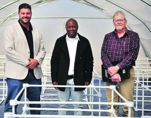 From left: Cannabisiness project manager Hennie Venter, VUT professor Fanyana Mtunzi andtechnical manager at VUT Willie Augustyn pose for a portrait inside a greenhouse where they will plant cannabis and hemp for their research. PICTURE: Cebile Ntuli