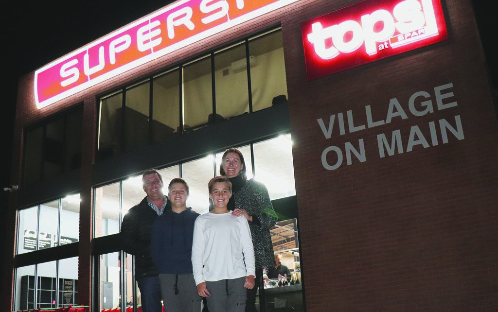 The brand new SuperSpar Village on Main and Tops Village on Main - situated in Main Street in Humansdorp - officially opened its doors to the public on Friday, June 14. Pictured at the new, upmarket shop are owner Richard Moolman, his wife, Joha, and their two sons Alexander (12) and Gian (10).         Photo:MONIQUE BASSON