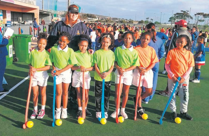 Die Heuwel Primary School is starting girls' hockey this year. The team had their first practice session at the SA Hockey Development Programme at the Gelvandale Astro Turf recently. With the u/10 team is coach Jacomien Oosthuizen. The team, from left, is Shanique Liberty, Asekho Bokoyi, Leah Swarts, Cursty van Wyk, Amyoli Soldaat, Siphahle Xola and Tashne Ruiters.  Photo: SUPPLIED