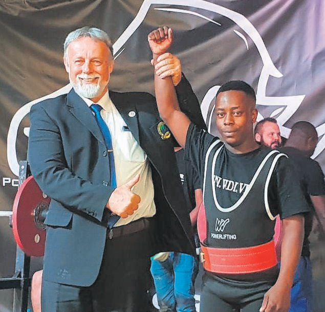 Westview School's powerlifting team recently competed in the Rhino National Championships in Silverton, Pretoria, where one of their learners set four new world records. Mandla Tshwaku now holds the record for bench press (77.5kg), squat (125kg), dead lift (162.5kg) and the combined weight of the three categories. In total, the powerlifting team won five gold medals and two silver. Pictured with Mandla is international ref Libhor Hurdalek. Photo:SUPPLIED