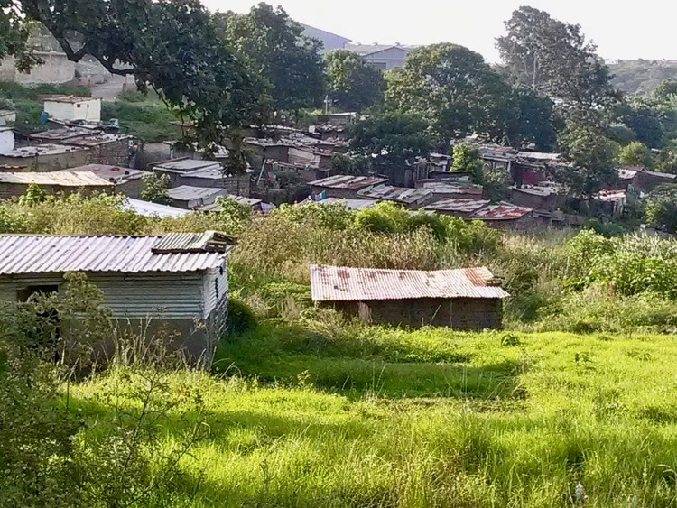 About 200 mud and shack houses in Katilumla, near Lusikisiki, are without electricity, sanitation or proper housing. (Sibahle Siqathule, GroundUp)