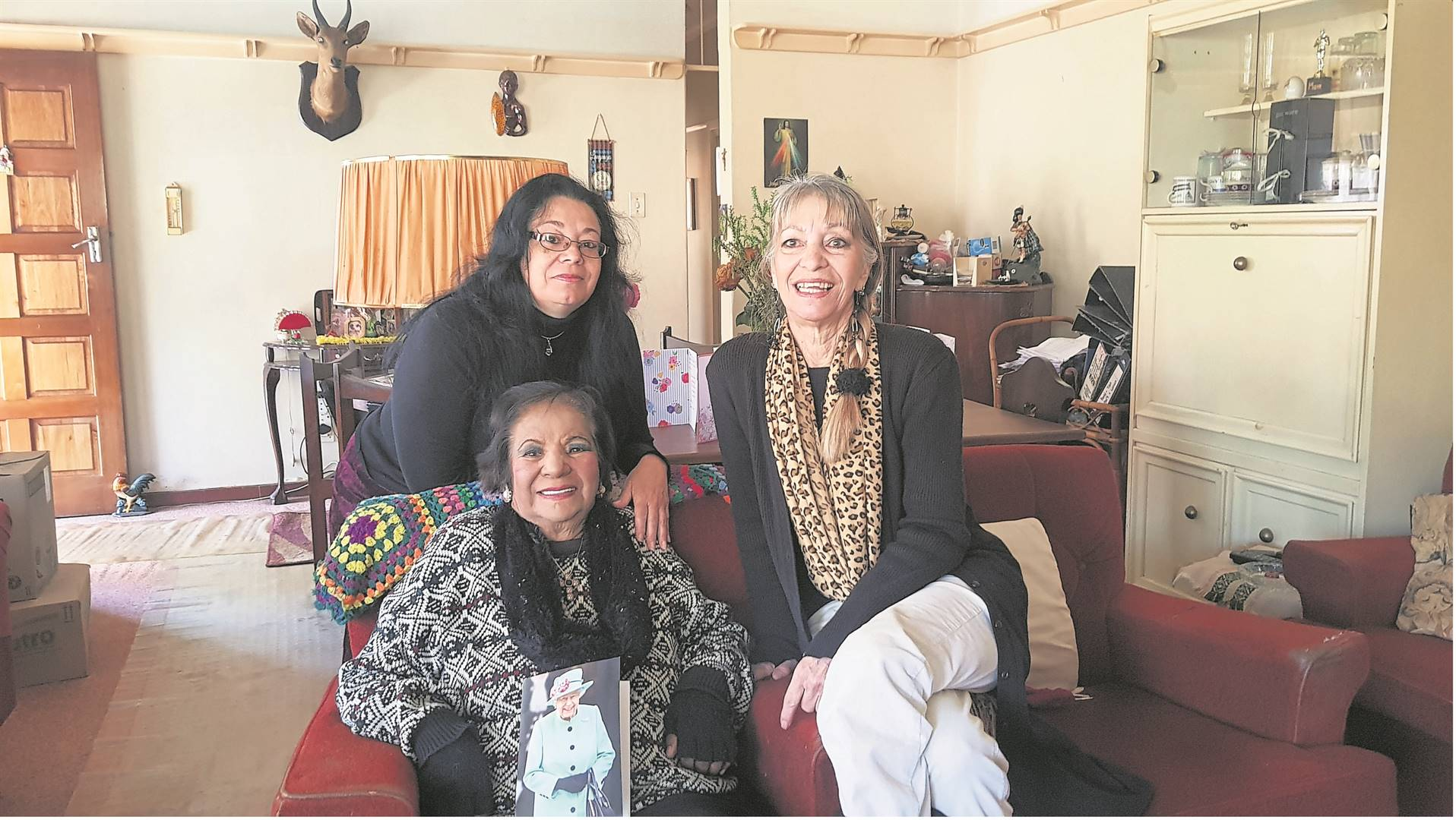 Pictured are 100-year-old Yvonne  Terris, her granddaughter (back row) Colleen Elliot and her daughter Idie Baker at Terris' home in Scottsville. PHOTO:byrone athman