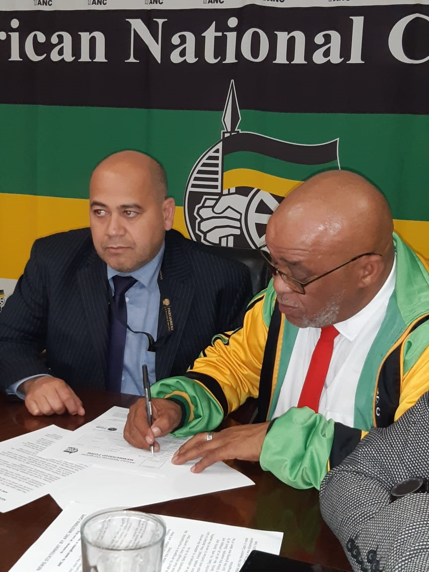 ANC provincial secretary Faiez Jacobs with Bertie Zass as he signs his ANC membership forms. (Tammy Petersen)