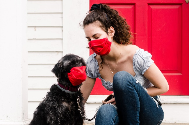 Woman and her dog wearing masks. (PHOTO: Cavan Images/Getty Images)