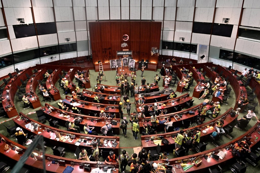 Protesters and members of the media are seen in the parliament chambers after protesters broke into the government headquarters in Hong Kong on July 1, 2019, on the 22nd anniversary of the city's handover from Britain to China.