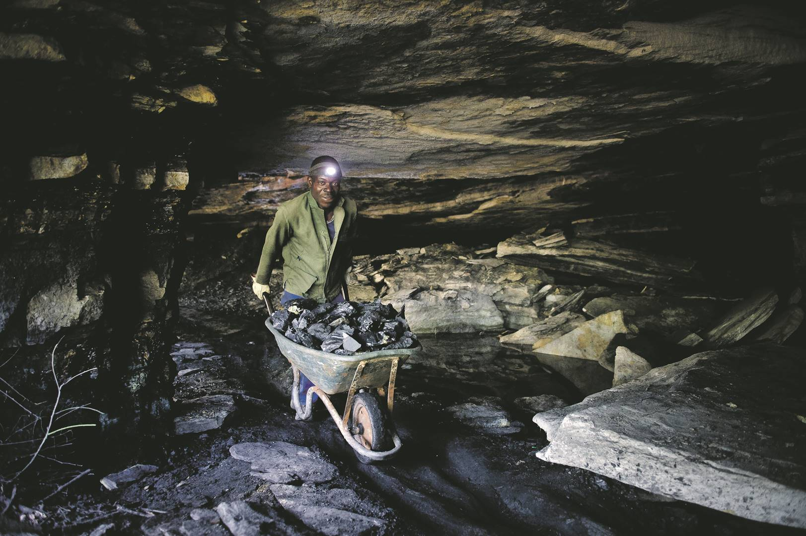 An illegal miner gathers coal in a mine in Ermelo, Mpumalanga. South Africa's lack of coherent policy direction and overreliance on coal will be detrimental to the country. Photo: Nelius Rademan