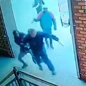 A man tries to escape two armed thieves at Bloemfontein Central Park. (Screengrab)