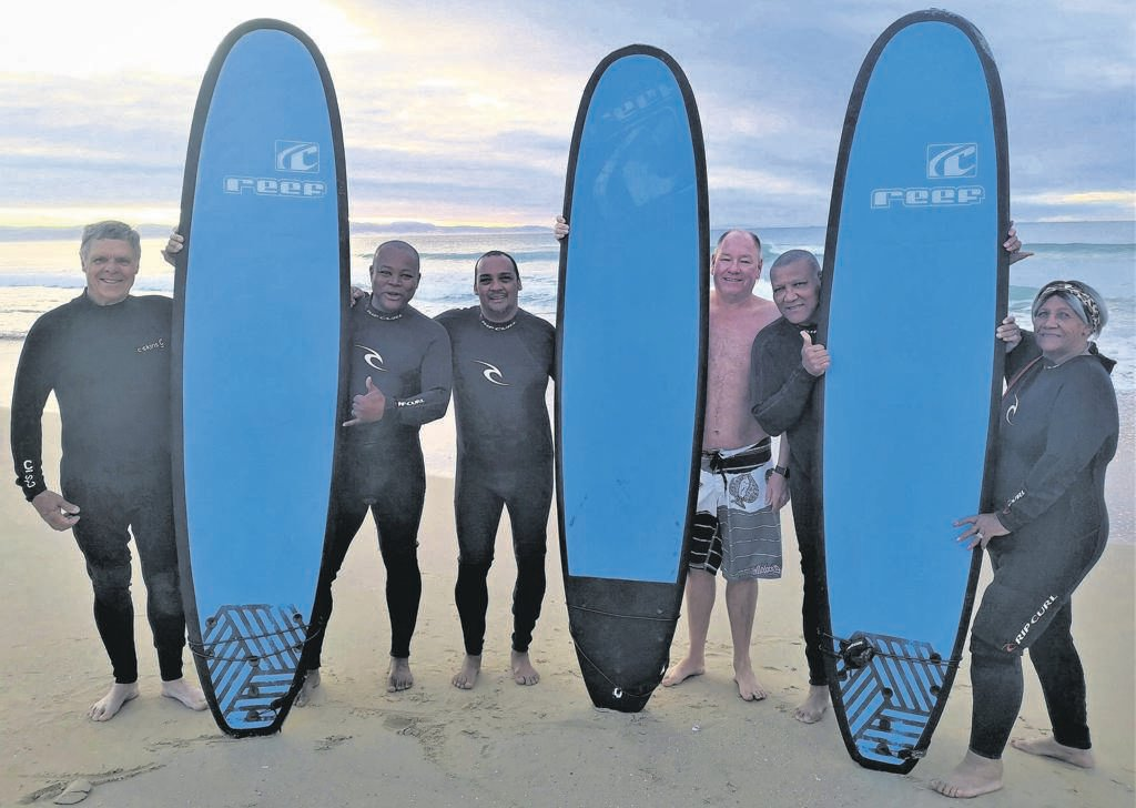 World-famous professional surfers, iconic athletes, top-class musicians and avid fishers will descend upon Jeffreys Bay for the JBay Winterfest that will take place from July 6 to 22 - drawing thousands of national and international visitors. The popular JBay Winterfest, one of the biggest winter festivals in the country, has a red-hot line-up of events: the Corona JBay Open, forming the backbone of the festival, trail running and the Winterfest Bowls Tournament - a first for the event Ready to welcome the world's top surfers to Jeffreys Bay are Kouga Mayor Horatio Hendricks (third left), Municipal Public Accounts Committee Chairman Willem Gertenbach and Mayoral Committee members Bryan Dhludhlu, Brenton Williams, Daniel Benson and Frances Baxter. They popped in for a quick surfing lesson at the Wavecrest Surf School this week. See page 6 for more information.          Photo:SUPPLIED