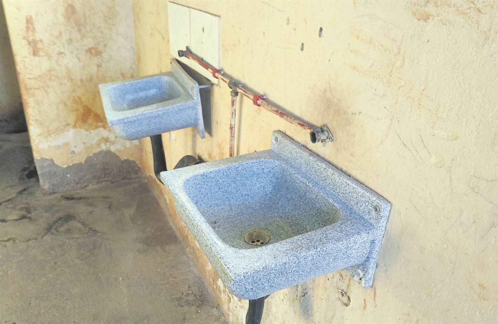 With no taps on the basins in a toilet at one local school, excrement is smeared on the adjacent wall.PHOTO: kerushun pillay