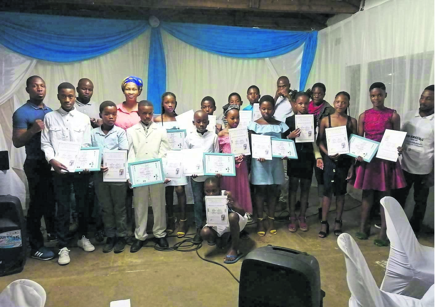 Members of Umvoti Aids Centre congratulate the young karatekas. photo: supplied
