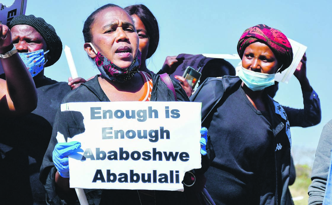 Residents of Mthwalume in KwaZulu-Natal protest during Police Minister Bheki Cele's visit on August 15 to an area where the serial killer dumped one of his victims. Community members believe the killings are continuing, despite a man confessing to the murders. Picture: Gallo Images