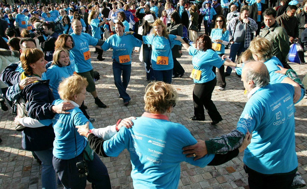 Members of Melbourne's Greek community join in during a giant traditional Greek Zorba dance. (AFP/William West)