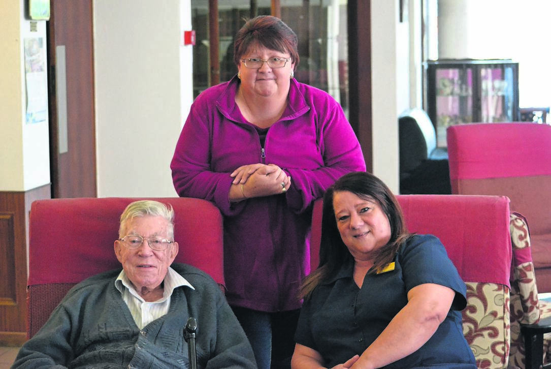 Brian Servant, one of just three remaining residents, with employees Antoinette Olivier and Petro Fourie in the lounge, which used to be filled with residents chatting.PHOTO: Moeketsi Mamane