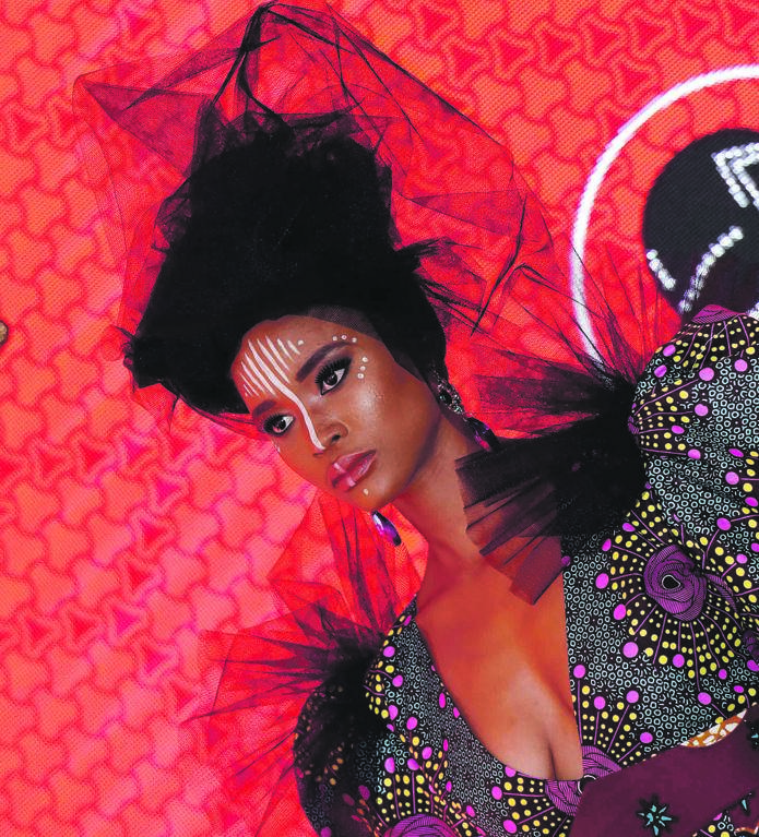 A model dressed in an Isishweshwe-inspired outfit stood out at a fashion show at the Vodacom Durban July. Picture: Tebogo Letsie