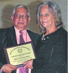 Merle Christina Bond receiving her award from Yusuf Bhamjee at the 2015 event.PHOTO: supplied