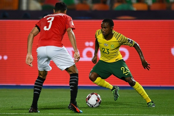 South Africas midfielder Thembinkosi Lorch (R) is