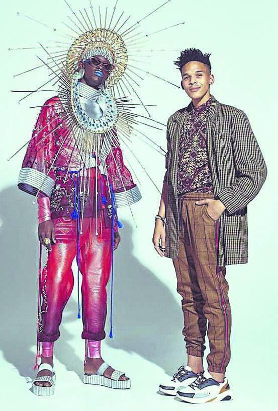 """School Of Fashion Design Graduate Martin Steenkamp made a huge impact at the Vodacom Durban July 2019.Steenkamp was one of 10 selected by Vodacom to create a look that was inspired by the given theme: """"Amazing Africa"""". Steenkamp was also selected by the Durban Fashion Fair to showcase in the Hospitality marquee. With him is 'Mathuba' GSA Models.PHOTO: supplied"""