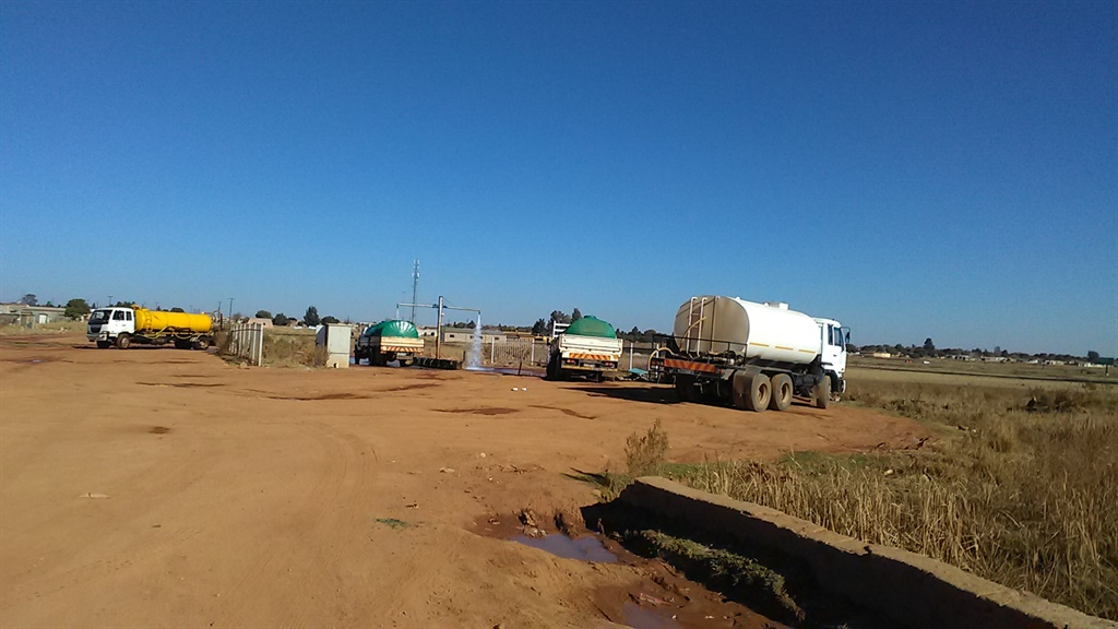 Trucks belonging to private water sellers and the Thembisile Hani Local Municipality fetch water from a pipe in Vezubuhle village in Mpumalanga. (Balise Mabona, News24)