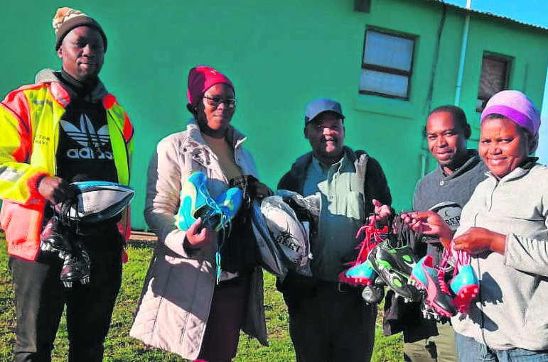 EAGLE Stars Rugby Club based in Tamboville, received sport equipment to the value of R17 300 from the ward 53 councillors' discretionary fund. The equipment included rugby boots, T-shirts and rugby balls. Seen here are (from left) Bongani Gwayi, Nomazulu Mthi (ward councillor), Tommy Joggoms (Eagle Stars RFC president), Fezile Mase (from the ward 53 councillors office) and Harriet Kondile (ward committee member). Photo:SUPPLIED