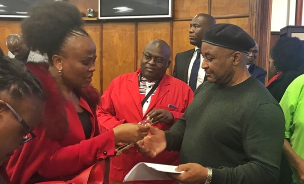 Public Protector Busisiwe Mkhwebane exchanges contact details with complainants after presenting her office's annual performance plan and budget to the Portfolio Committee on Justice and Correctional Services. (File: Supplied)