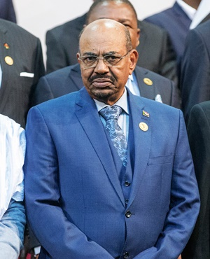 Sudanese President Omar al-Bashir arrives for a group photograph of leaders at the 25th AU Summit in Johannesburg. (Gianluigi Guercia, AFP)