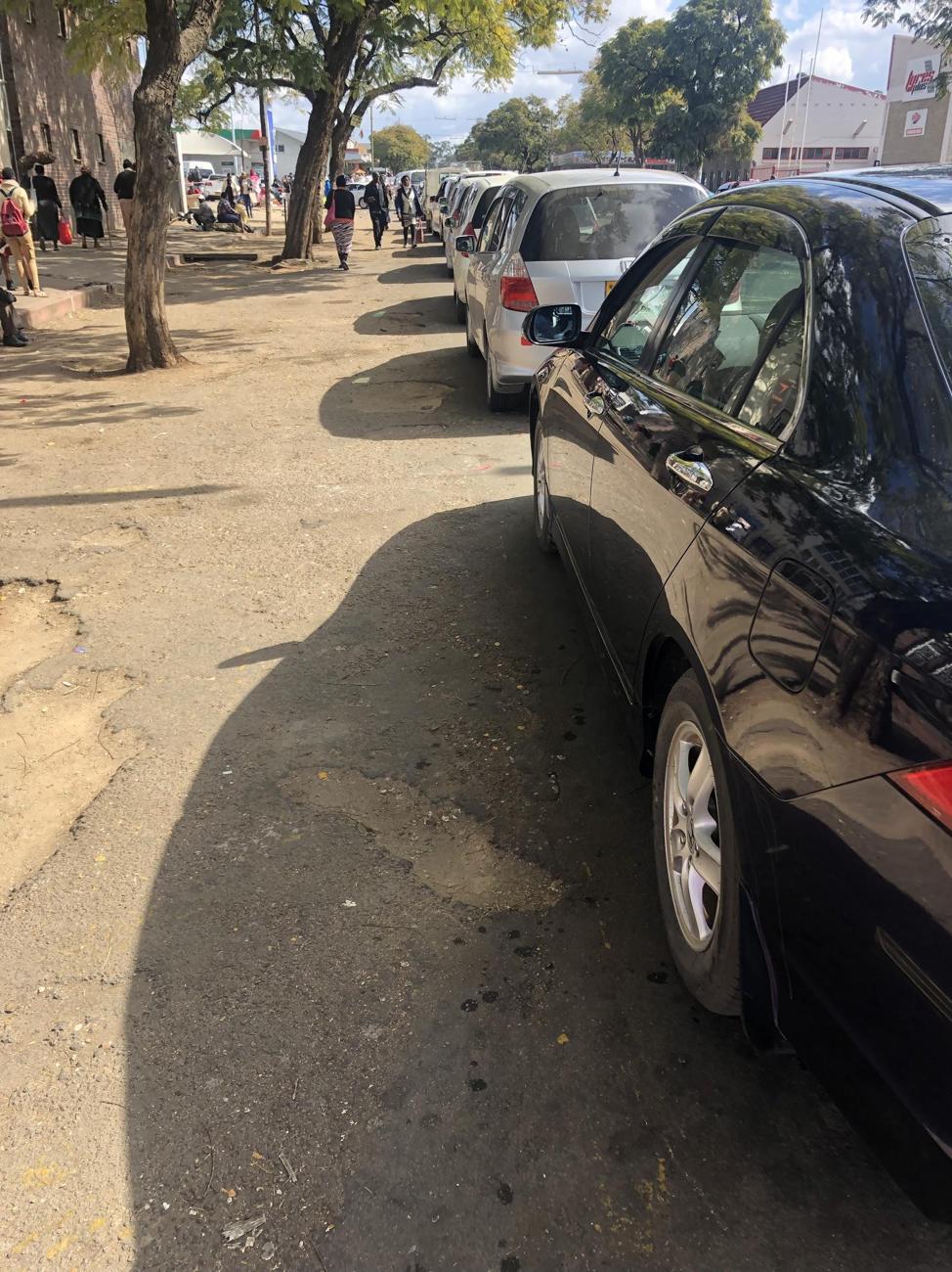 Line at a Bulawayo petrol station while attendants