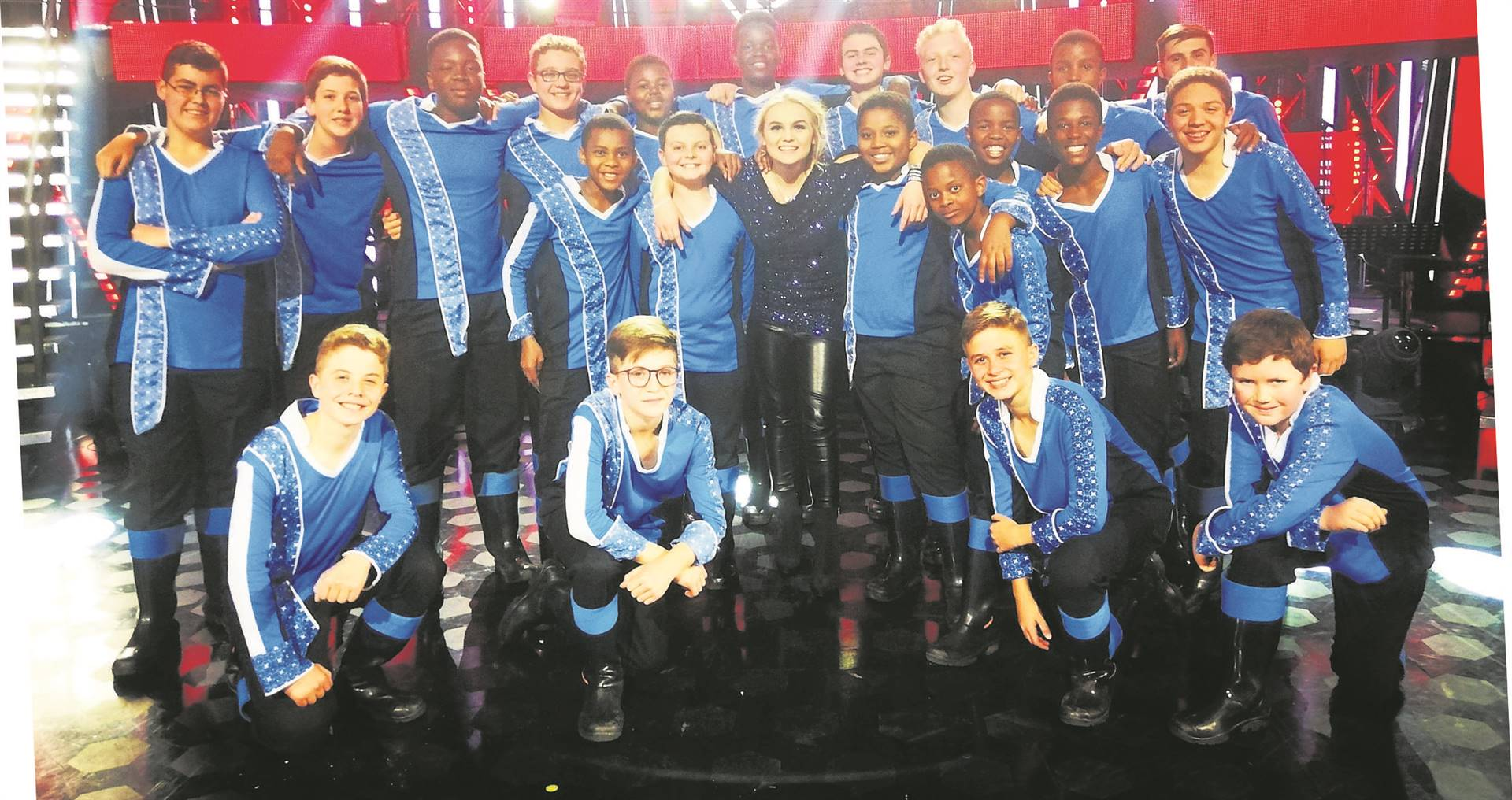 The world-famous Drakensberg Boys Choir recently appeared as a guest act on The Voice SA. The 24 boys were excited to work with the top musicians and industry specialists involved with the show. During the show, the boys performed the opening act of Special Star with the final seven contestants, paying tribute to Mango Groove. Later in the show, the boys joined contestants in performing Queen's Bohemian Rhapsody, Johnny Clegg's The Crossing, and the show culminated in a performance with Fokofpolisiekar frontman and The Voice SA judge, Francois van Coke. They sang the band's song Komma. See the video on YouTube at www.youtube.com/watch?v=QBW4MqbmDCASeen here with are the 24 boys is the final winner of The Voice SA 2019, Tasché Burger.PHOTO: supplied