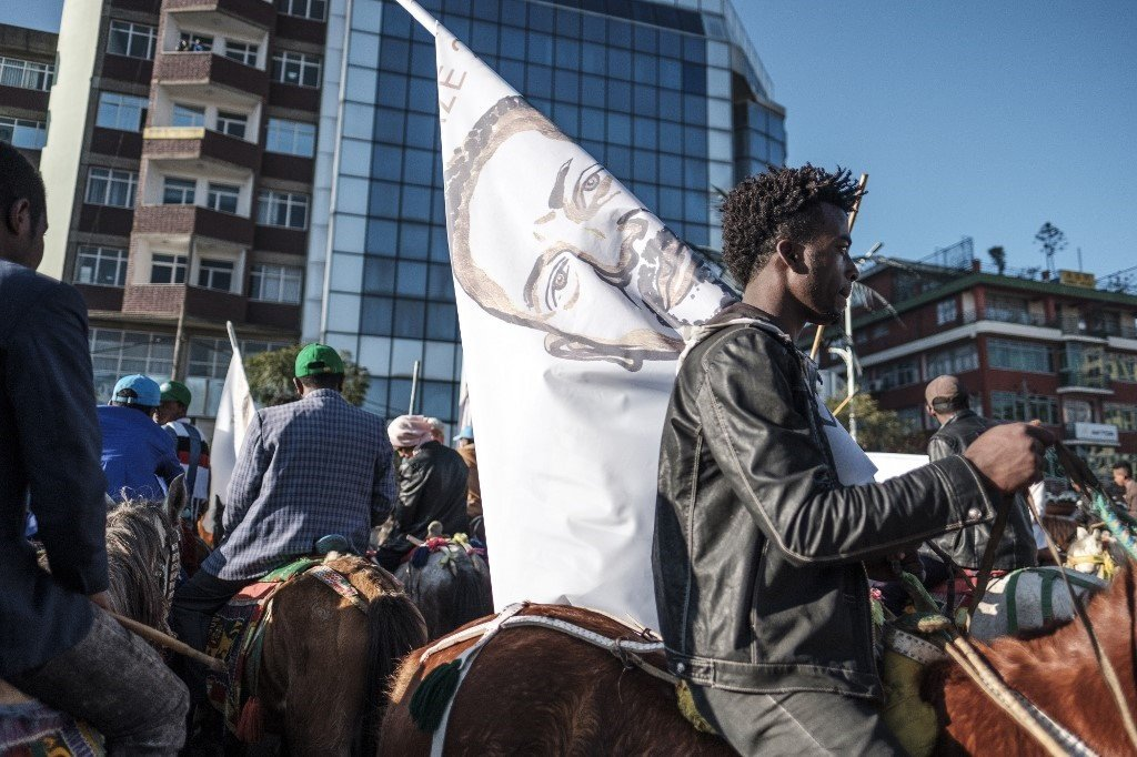 A horseman holds a flag depicting Ethiopian Prime Minister Abiy Ahmed. File Photo.