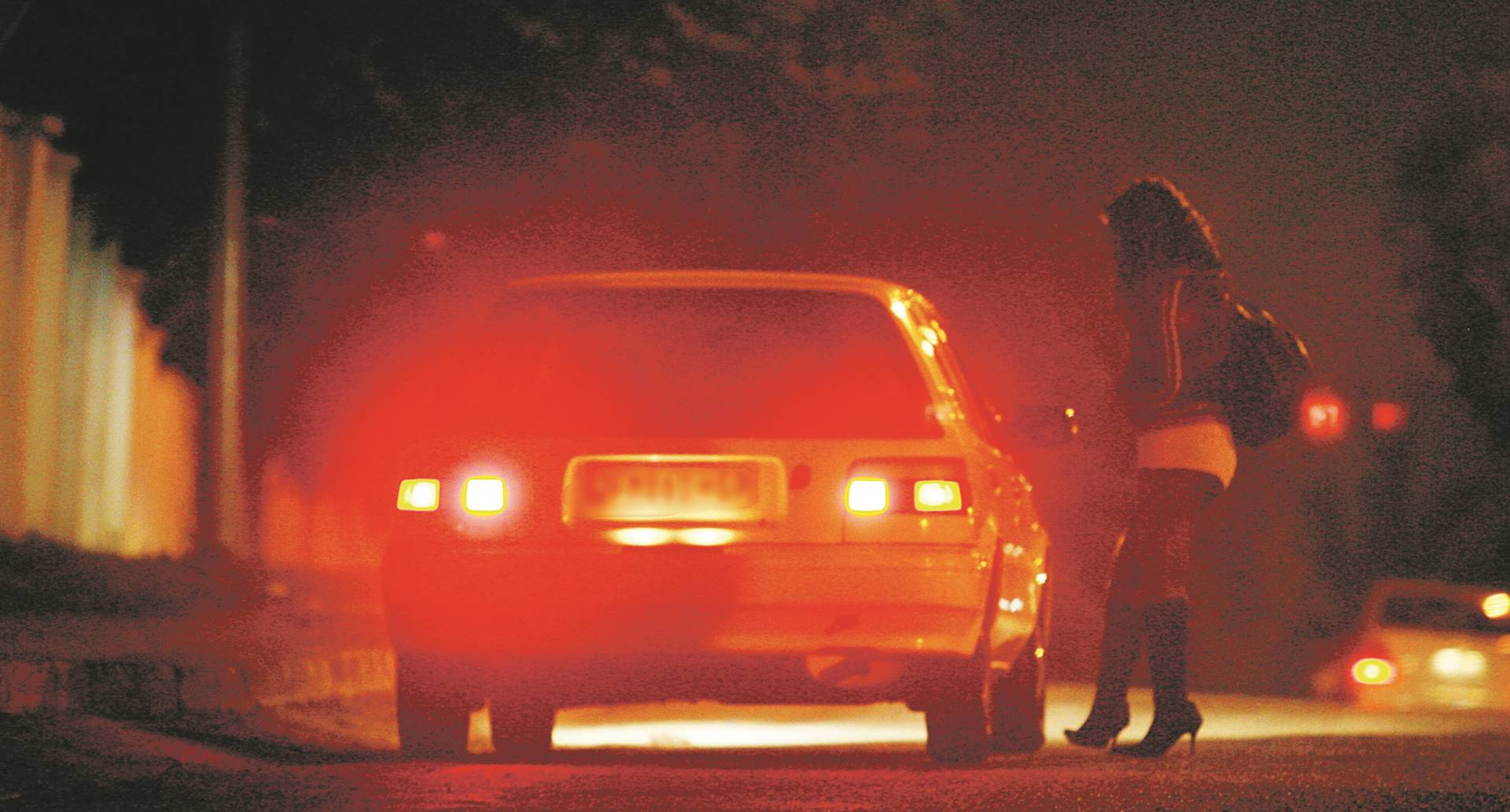 A sex worker negotiates with a motorist customer. Picture: Leon Sadiki