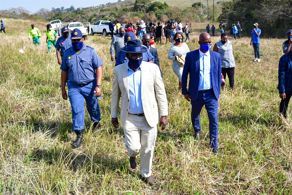 Police Minister Bheki Cele visits the crime scene in Mthwalume following the discovery of five bodies of women over the past few days.