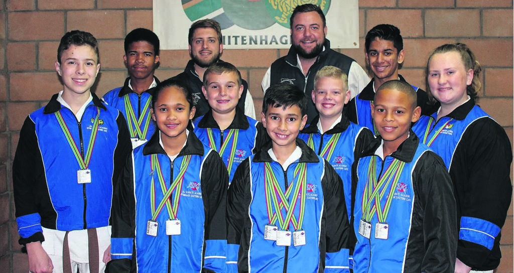 <THESE L&J Karate students participated and won medals in the 35th JSKA national championships in Pretoria. At the back from left are Stephan Terblanche (instructor), Jaco van Staden (chief instructor). Second row from left are Pieter van der Smit (1 bronze), Haywin Kriel (1 gold & 1 silver), Stephen Sharp (2 bronze), Morne van Zyl (2 silver), Eshaan Prag (3 gold & 1 silver), Jenna Mirams (1 bronze). In front are Danica Basson (2 gold), Ethan Bothma (3 gold) and Lionel Martin (1 gold, 1 silver & 1 bronze).                                Photo:SUPPLIED