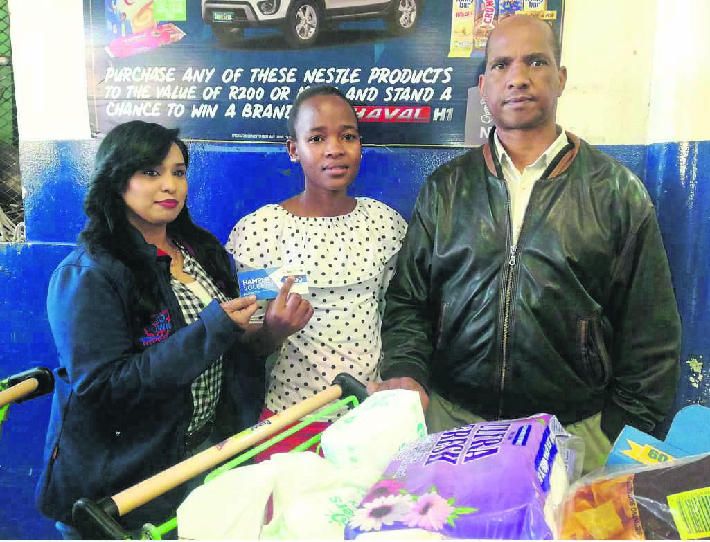 Presenting the voucher to Aviwe Mqambeli (centre) is Nisha Ori from SuperSave (left), and Gift Majola from Echo (right).PHOTO: supplied