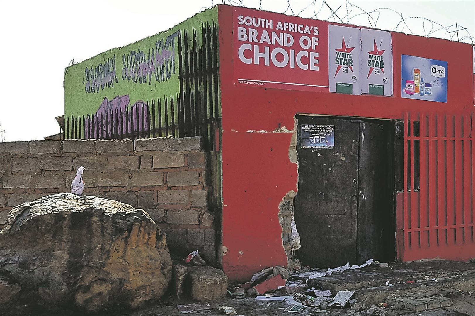 What is left of a foreign-owned shop front after looting. Picture: Tebogo Letsie