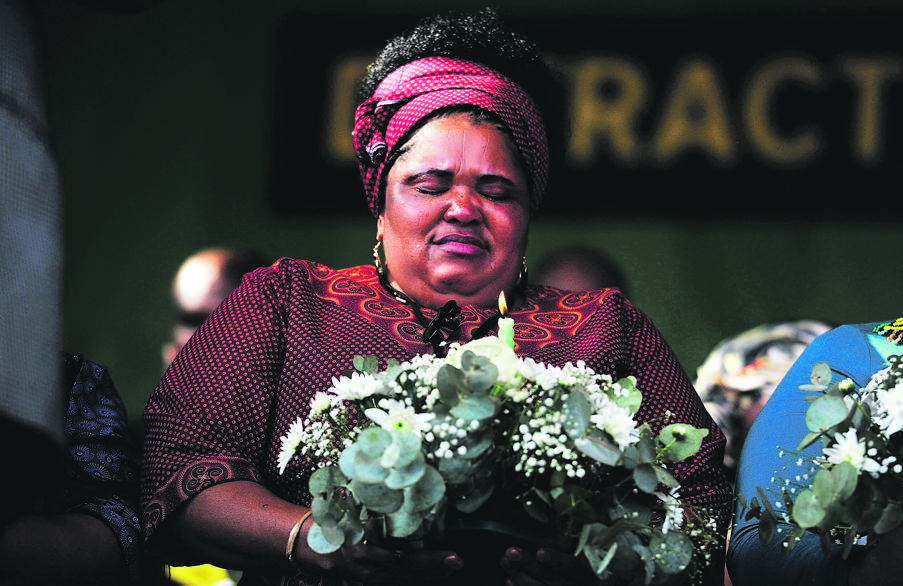 One of the widows of the 44 men killed at Lonmin's platinum mine in Marikana in 2012 paid tribute to her husband in a memorial service held on Friday to mark seven years since the massacre. Picture: Rosetta Msimango