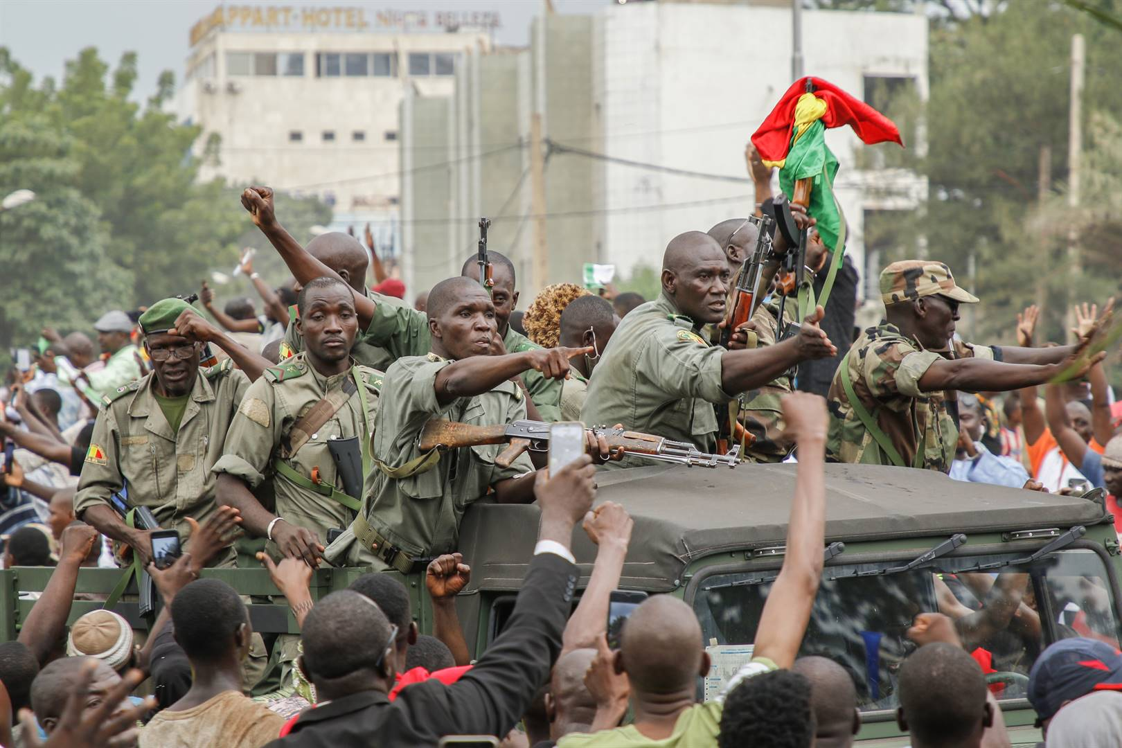 Hundreds of anti-government protesters gather in Bamako to applaud the soldiers for their actions against President Ibrahim Boubacar Keita
