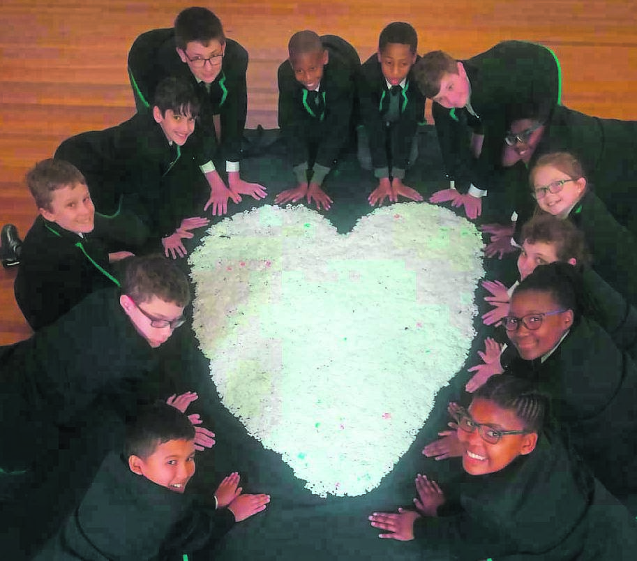 The learners of Elsen Academy had a blast on Mandela Day this year. They have been collecting plastic bottle tops and bread tags on an ongoing basis for the Sweethearts Foundation, who provide wheelchairs to those in need, from the proceeds of recycling the tops and tags. The Grade 6 class formed a heart shape from bread tags collected in honour of this special day. From left are Tristan Alexander, Tristan Becker, James van Gruting, Ethan Havenga, Declan Begley, Luthando Nkantsu, Sanovuyo Mahashe, Connor Edmeades, Temba Scheffer, Nicole Wiseman, Alné van Eeden, Esona Fundani and Asakha Tyanase.  Photo:SUPPLIED